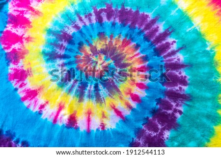 Fashionable Pastel Blue, Yellow Red, Green, Purple Retro Abstract Psychedelic Tie Dye Swirl Design. Royalty-Free Stock Photo #1912544113