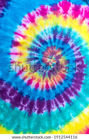 Fashionable Pastel Blue, Yellow Red, Green, Purple Retro Abstract Psychedelic Tie Dye Swirl Design. Royalty-Free Stock Photo #1912544116