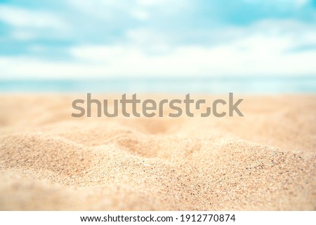 Tropical summer sand beach on sea background, copy space. Royalty-Free Stock Photo #1912770874