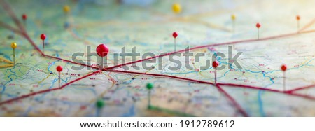 Find your way. Location marking with a pin on a map with routes. Adventure, discovery, navigation, communication, logistics, geography, transport and travel theme concept background. Royalty-Free Stock Photo #1912789612