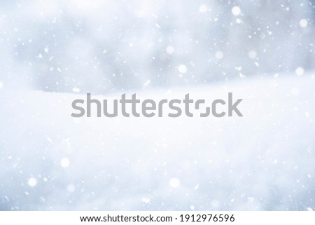 Winter landscape. It's snowy. Snowflakes, drifts of snow. At close range. Snowfall. Nature. Recording space, free space. Background. Royalty-Free Stock Photo #1912976596