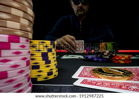 High stakes Texas hold 'em poker game at the casino Royalty-Free Stock Photo #1912987225