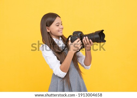 having skills. snapshot. childhood. teen girl taking photo. kid use digital camera. happy child photographing. school of photography. hobby or future career. photographer beginner with modern camera.