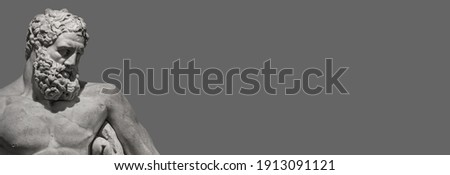 Banner with an ancient Greek statue of powerful Hercules, or Heracles, closeup, isolated at grey solid background with copy space. Concept fitness, health and sport Royalty-Free Stock Photo #1913091121