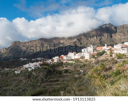 Picturesque Canarian village Tejeda in mountain valley scenery and view of bentayga rock Gran Canaria, Canary Islands, Spain Royalty-Free Stock Photo #1913113825