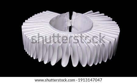 white ruff or ruffled or millstone collar isolated on black background - historic renaissance fashion Royalty-Free Stock Photo #1913147047