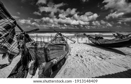 A Wooden Fishing Boat at Seashore Monochrome Photography