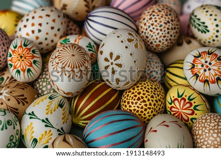 Happy Easter.Colorful hand painted decorated Easter eggs. Handmade Easter craft.Spring decoration background. DIY Festive traditional symbols.Holiday Still life photo selective focus Royalty-Free Stock Photo #1913148493