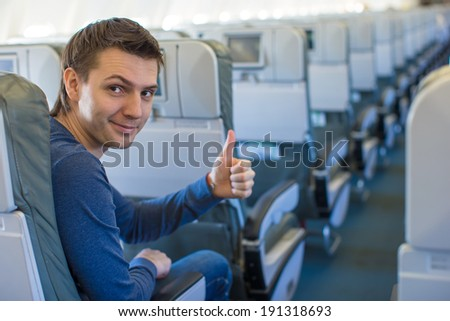 Happy man showing thumbs up inside the aircraft #191318693