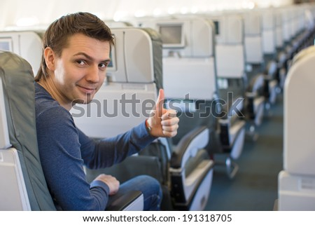 Happy man showing thumbs up inside the aircraft #191318705
