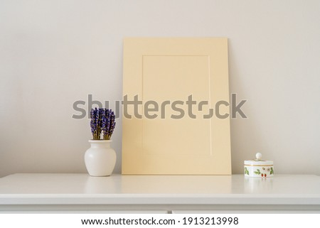 Cardboard Picture mount interior mock up with Vase containing Lavender and a small trinket pot