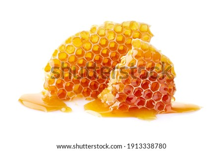 Honeycomb with honey drop on white background Royalty-Free Stock Photo #1913338780