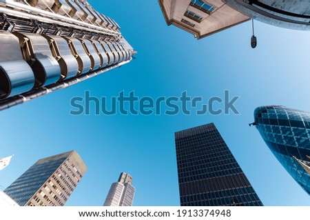 Looking directly up at the skyline of the financial district in the City of London Royalty-Free Stock Photo #1913374948