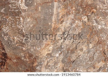 Natural stone background. High resolution brown natural stone surface. Rustic structural stone.