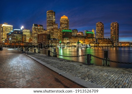 Panorama of Boston skyline from Fan Pier at the fantastic twilight time with smooth water river in boston, Massachusetts, USA downtown skyline,Architecture and building with tourist and travel concept Royalty-Free Stock Photo #1913526709