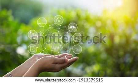 Technology, hand holding with environment Icons over the Network connection on green background. Royalty-Free Stock Photo #1913579515