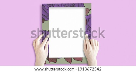 hand holding blank picture frame.