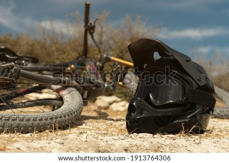 Professional MTB bike and helmet with a protective goggles for downhill cycling in mountains Royalty-Free Stock Photo #1913764306
