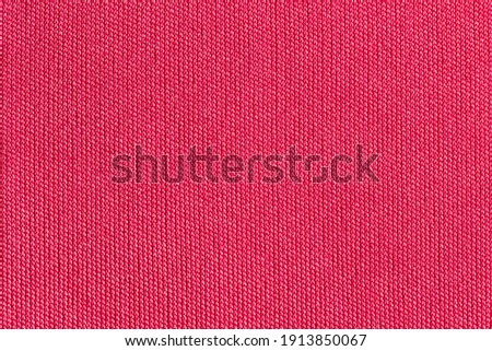 Red fabric cloth polyester texture background. Royalty-Free Stock Photo #1913850067
