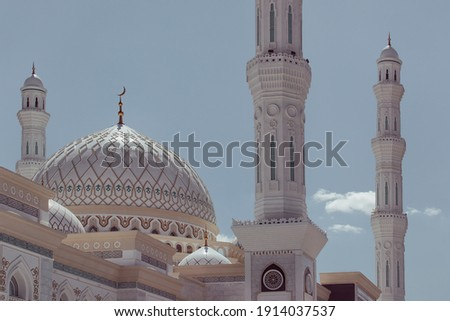Domes and minarets. Beautiful Landscape mosque. Amazing Islamic architecture and decoration. Islam, religion and architecture. Kazakhstan, Central Asia.  Royalty-Free Stock Photo #1914037537