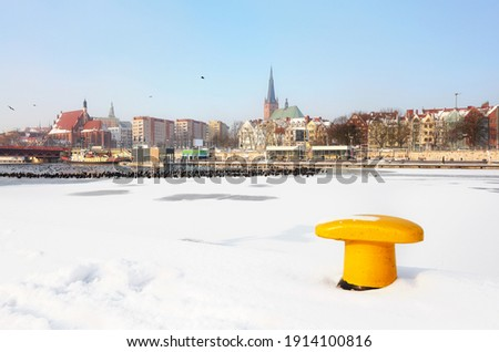 Szczecin waterfront with frozen Odra River in winter, Poland. Royalty-Free Stock Photo #1914100816