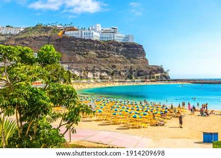 Picturesque Amadores beach (Spanish: Playa del Amadores) near famous holiday resort Puerto Rico de Gran Canaria on Gran Canaria island, Spain. Sunny day in December Royalty-Free Stock Photo #1914209698