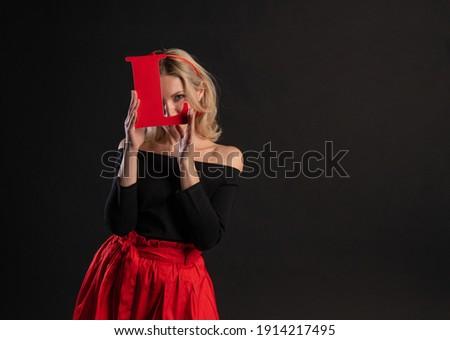 Girl holding letters word LOVE love symbol, flirt design, on the floor hearts married romance. inspiration is art. dream forever, engagement in red dress girl, barefoot