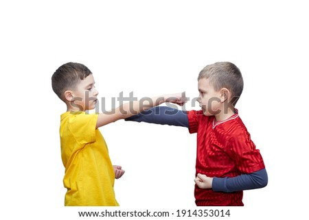 Athletes in red and yellow T-shirts perform punches to meet each other on a white background Royalty-Free Stock Photo #1914353014