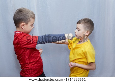 Athletes in red and yellow t-shirts beat punches to meet each other Royalty-Free Stock Photo #1914353551