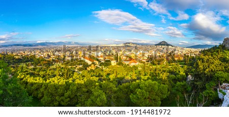 Panoramic aerial view of city of Athens, Attica, Greece. Skyline view from Areopagus hill. Lycabettus Hill on the right. Sunny autumn day Royalty-Free Stock Photo #1914481972