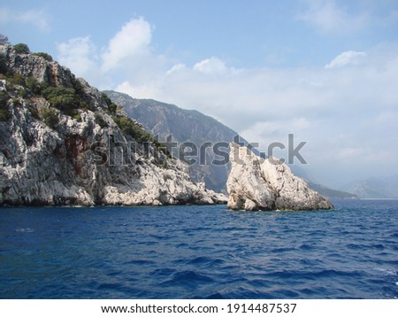 Lycian coast. Turkey. 10.09. 2020. Amazing natural picture of snow-white coastal rocks barely decorated with mountain vegetation surrounded by gentle sea blue.