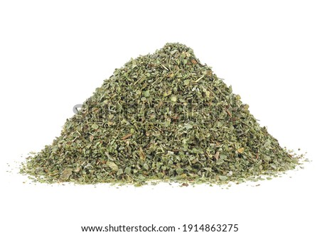 Aromatic spice - pile of dried marjoram spice isolated on a white background. Dried of marjoram leaves. Royalty-Free Stock Photo #1914863275
