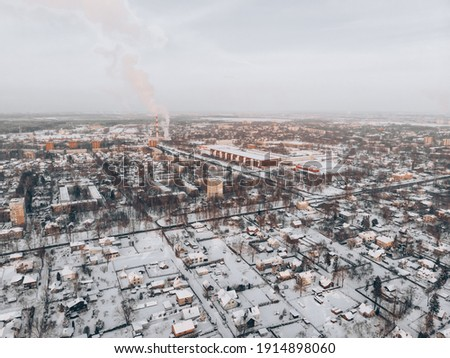 aerial drone view of houses and road. winter landscape. Royalty-Free Stock Photo #1914898060