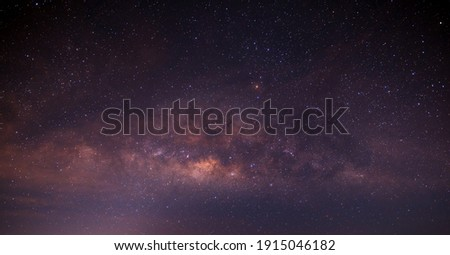 Panorama purple and blue night sky milky way and star on dark background.with noise and  grain.Photo by long exposure and select white balance.
