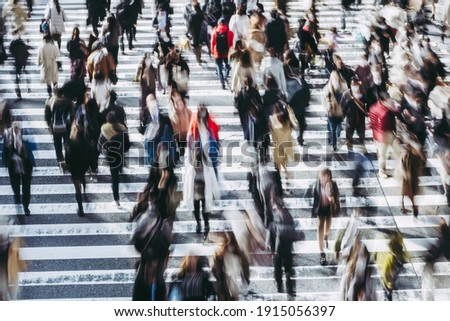 People crossing the pedestrian crossing in Osaka Royalty-Free Stock Photo #1915056397