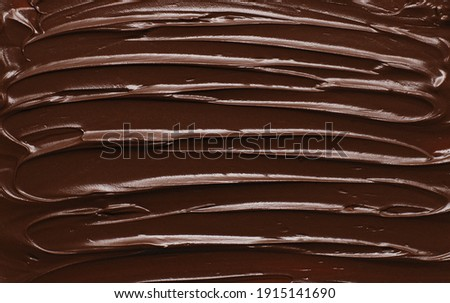 Melted chocolate background, Chocolate spread texture, top view Royalty-Free Stock Photo #1915141690