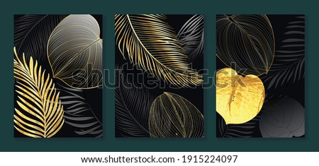 Luxury gold wallpaper.  Black and golden abstract background. Tropical leaves wall art design with dark blue and green color, shiny golden light texture. Modern art mural wallpaper. Royalty-Free Stock Photo #1915224097