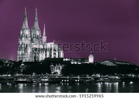 Cologne, Germany. Night View Of Cologne Cathedral. Catholic Gothic Cathedral In Night. UNESCO World Heritage Site. Toned Photo Black, White And Ultra Violet Colors.