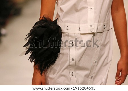Fashion show. Catwalk event. Unrecognisable model. Close-up details of fashionable clothes Royalty-Free Stock Photo #1915284535