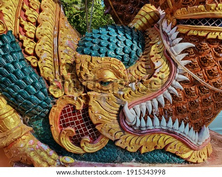 Colorful mythical creatures on temple's staircase rail  Royalty-Free Stock Photo #1915343998