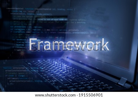Framework inscription against laptop and code background. Technology concept. Royalty-Free Stock Photo #1915506901