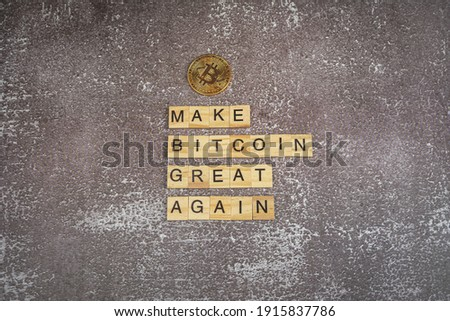 Make bitcoin great again, funny sign about cryptocurrency with wooden blocks