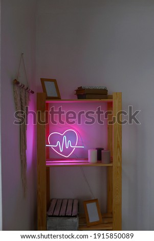 Neon sign pink and blue heart in the decor of the home. Trendy style. Neon sign. Custom neon. Home decor. Valentine day. Modern trendy background.