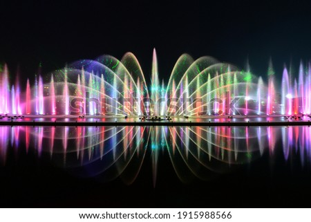 A fountain is a piece of architecture which pours water into a basin or jets it into the air to supply drinking water andor for a decorative or dramatic effect. Royalty-Free Stock Photo #1915988566