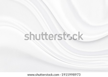 White gray satin texture that is white silver fabric silk background with beautiful soft blur pattern natural. Royalty-Free Stock Photo #1915998973