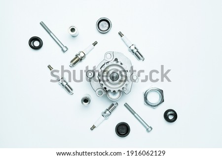 Car motor parts. Auto motor mechanic spare or automotive piece on white background. Set of new metal car part. Flat lay, top view, copy space Royalty-Free Stock Photo #1916062129