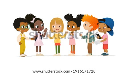 Group of multicultural children talk to each other. School boy with vitiligo say hello to new friends. Asian boy scan QR code. School friends have fun. Royalty-Free Stock Photo #1916171728