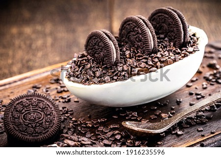 brazilian easter dessert, chocolate egg with cream filling, brazilian brigadier bonbons, biscuit and sugar Royalty-Free Stock Photo #1916235596