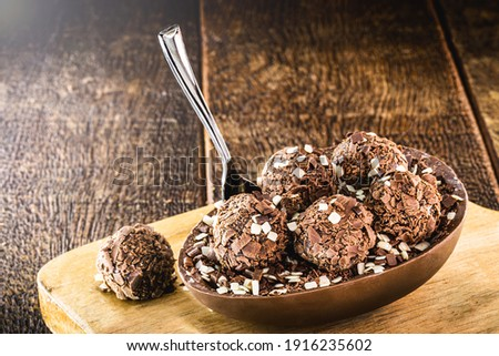 brazilian easter dessert, chocolate egg with cream filling, brazilian brigadier bonbons, biscuit and sugar, called a spoon egg Royalty-Free Stock Photo #1916235602