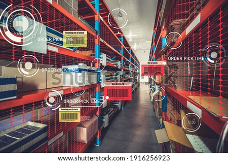 Smart warehouse management system using augmented reality technology to identify package picking and delivery . Future concept of supply chain and logistic business . Royalty-Free Stock Photo #1916256923